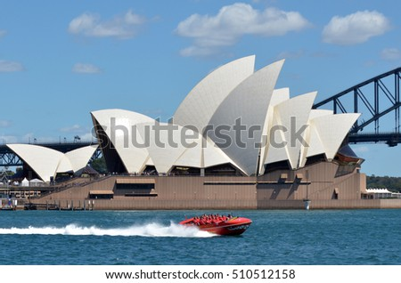 SYDNEY, AUS  - OCT 23 2016: Sydney Harbour Jet Speed Boats sail under Sydney Opera House and Sydney Harbour Bridge in  Sydney, New South Wales, Australia.