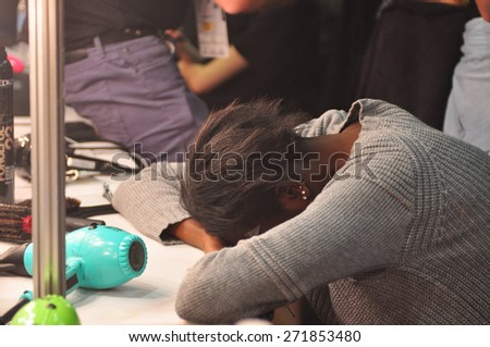 SYDNEY AUSTRALIA - APRIL 16: A tired model backstage during Gail Sorronda fashion show at Mercedes Benz Fashion Week in Carriageworks Sydney Australia. Exclusively for Shutterstock - stock photo