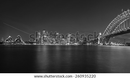 SYDNEY, AUSTRALIA April 02, 2014: Sydney's opera house and skyline seen from the harbour bridge at nighttime seen from bradfield park  - stock photo