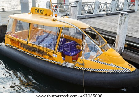 SYDNEY, AUSTRALIA - APRIL, 2016 : Sydney Yellow Water taxi docking at the pier at Darling Harbour ferry terminal in Sydney, Australia on April 19, 2016.
