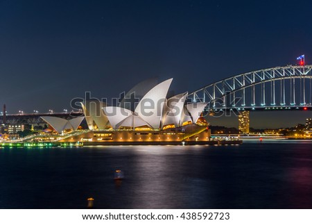 SYDNEY, AUSTRALIA - APRIL 21: View on Sydney opera and Harbour bridge in purple sunset, long exposure. April 2016