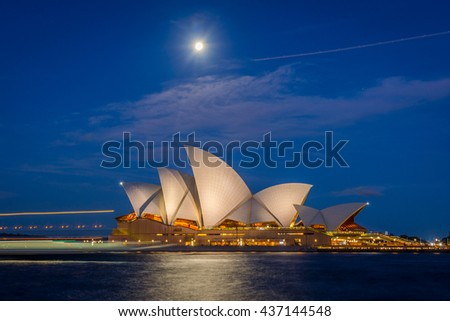 SYDNEY, AUSTRALIA - APRIL 19: View on Sydney Opera house at night and ferry lights infront, long exposure. April 2016