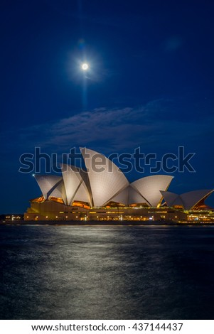 SYDNEY, AUSTRALIA - APRIL 19: View on Sydney Opera house with moon at night, long exposure. April 2016