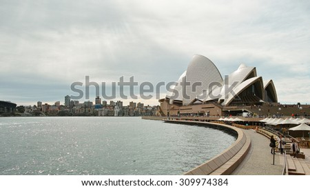 SYDNEY, AUSTRALIA - Aug. 2, 2015:: Sydney Opera House viewed from Circular Quay. It is a multi-venue performing arts centre also containing bars and outdoor restaurants. - stock photo