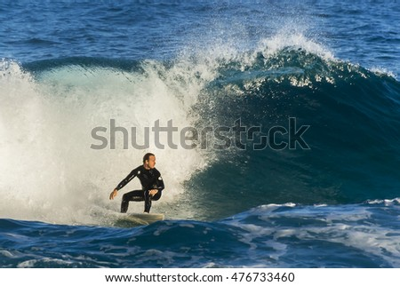 Sydney, Australia - August 27, 2016. Young surfer surfing at Tamarama beach.