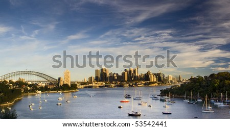 Sydney Australia city and bridge bay yacht panoramic sunset warm colorful view - stock photo
