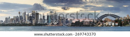 Sydney Australia city CBD landmark panoramic view from Cremorn point across sydney harbour with Harbour bridge on horizon - shoot at sunset  - stock photo