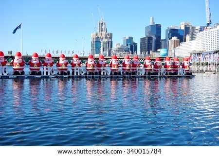 """SYDNEY, AUSTRALIA --15 DECEMBER 2014-- Christmas is celebrated """"down under"""" in Sydney, Australia, during summer with pine tree, Santa Claus and reindeer decorations throughout the city. - stock photo"""