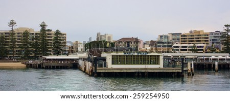 SYDNEY, AUSTRALIA  - DECEMBER 10, 2014: Manly Wharf near Sydney on 10 December 2014 in Sydney, Australia. Manly is sunbathing and relaxing place located not far from the center of Sydney