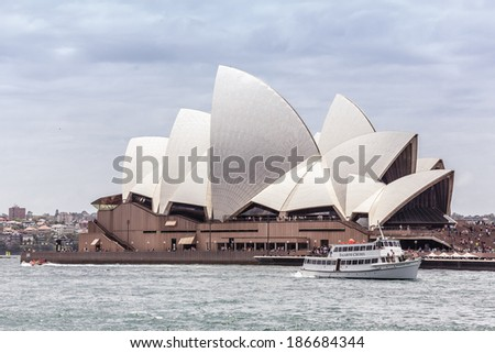 SYDNEY, AUSTRALIA - DECEMBER 26, 2012: Sydney Opera House is a multi-venue performing arts centre also containing bars and outdoor restaurants on December 26, 2012, Australia.