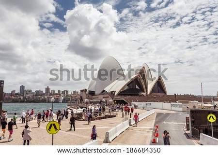 SYDNEY, AUSTRALIA - DECEMBER 26, 2012: Sydney Opera House is a multi-venue performing arts centre also containing bars and outdoor restaurants on December 26, 2012, Australia. - stock photo