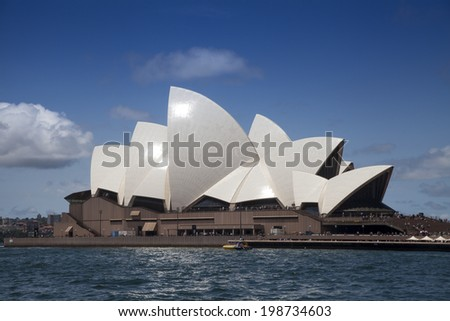 SYDNEY, AUSTRALIA - DECEMBER 27, 2013: The Sydney Opera House shines in the midday sun in Sydney Harbour. The Opera House celebrated its 40th anniversary in 2013.