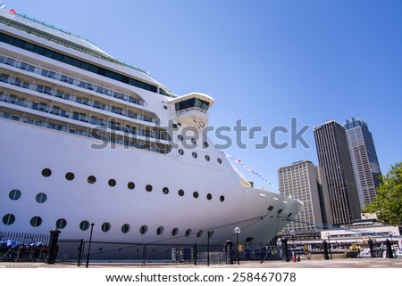 SYDNEY, AUSTRALIA - FEBRUARY 12, 2015: Cruier in the Sydney port. With more than 2.7 million international visitors, Sydney is 42nd most visited city in the world - stock photo