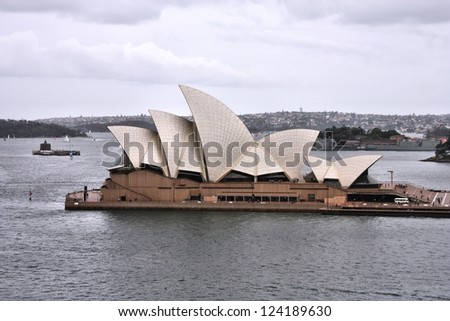 SYDNEY, AUSTRALIA - FEBRUARY 14: People visit Opera House on February 14, 2008 in Sydney, Australia. Famous building finished in 1973 is a UNESCO World Heritage Site. - stock photo