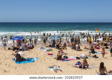 SYDNEY, AUSTRALIA - FEBRUARY 02, 2014: Unidentified people sunbathe on Manly beach. Manly is a famous beach and popular Sydney seaside resort.