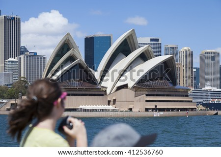 SYDNEY / AUSTRALIA - February 2 2014: Unknown tourist takes pictures. The Sydney Opera House is a multi-venue performing arts centre, identified as one of the 20th century's most distinctive buildings