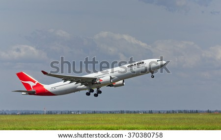 SYDNEY,AUSTRALIA - JANUARY 31,2016: An Airbus A330 of QANTAS takes off from the city's airport. The airport is located 5 miles south of the city centre. - stock photo