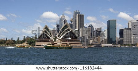SYDNEY, AUSTRALIA - JANUARY 30, 2012: Famous 'Sydney Opera House' is the UNESCO Heritage Site. Opera, designed by Danish architect Jorn Utzon, was opened in 1975. January 30, 2012, Sydney, Australia. - stock photo