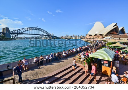 Sydney, Australia - January 23, 2015: People relaxing and dining along the Circular Quay in a sunny afternoon in Sydney, Australia. - stock photo