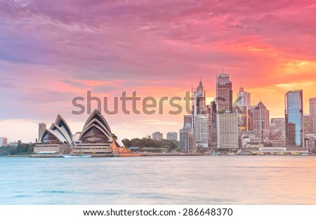 Sydney, Australia - January 23, 2015: Sydney Harbor and Opera House at dusk on January 23, 2015 in Sydney, Australia. - stock photo