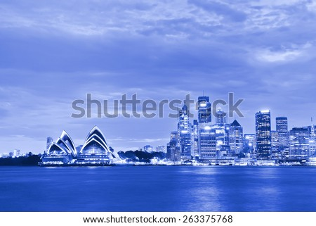 Sydney, Australia - January 23: Sydney Harbor and Opera House at twilight on January 23, 2015 in Sydney, Australia. The Opera House is one of the most famous performing arts centers in the world. - stock photo