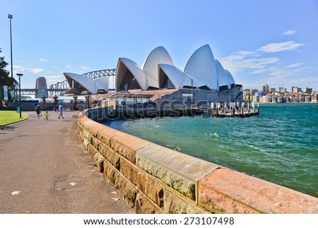 Sydney, Australia - January 23: Sydney Opera House and Harbor Bridge in a sunny day on January 23, 2015 in Sydney, Australia.  - stock photo