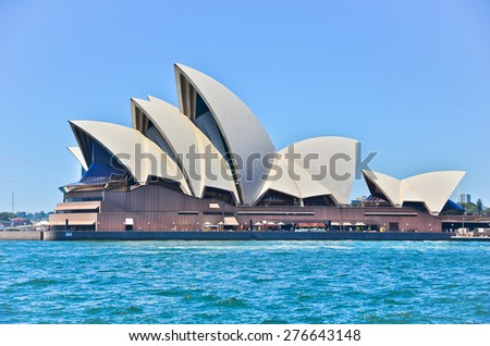 Sydney, Australia - January 25: Sydney Opera House in a sunny day on January 25, 2015 in Sydney, Australia. The Sydney Opera House is one of the most famous buildings in the world. - stock photo