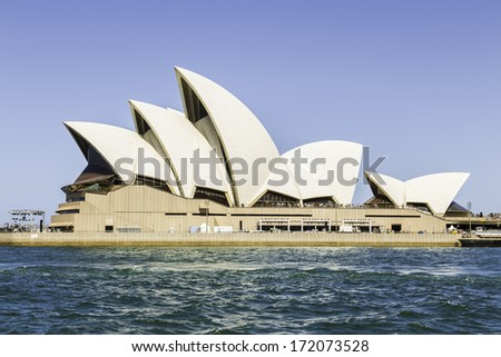 SYDNEY, AUSTRALIA - JANUARY 4: Sydney Opera House view on January 4, 2014 in Sydney, Australia. The Sydney Opera House is a famous arts center. It was designed by Danish architect Jorn Utzon. - stock photo