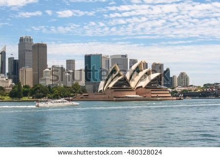SYDNEY, AUSTRALIA - JANUARY 10, 2012 : Sydney Opera House with ferry and many buildings