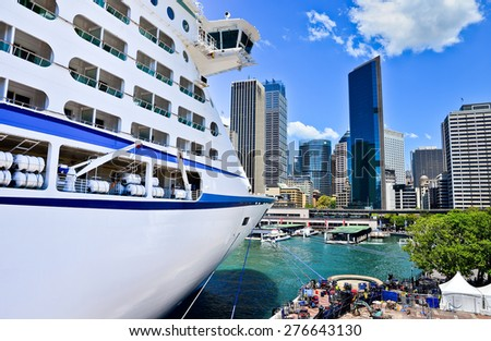 Sydney, Australia - January 25: Sydney skyline and a cruise ship in Sydney Harbour on January 25, 2015 in Sydney, Australia. - stock photo