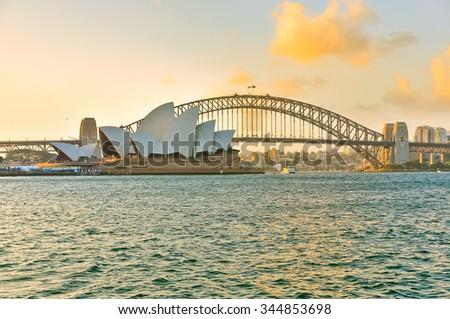 Sydney, Australia - January 25: View of Sydney Harbor Bridge and Opera House at sunset on January 25, 2015 in Sydney, Australia.  - stock photo