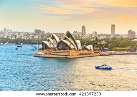 Sydney, Australia - January 23 : View of the Sydney Harbour with some ferries passing by Sydney Opera House on January 23, 2015 in Sydney, Australia.  - stock photo