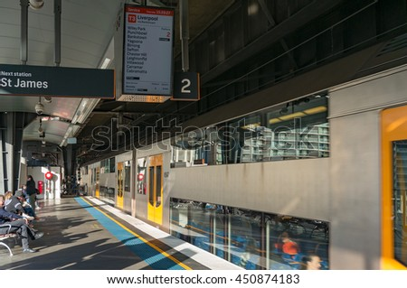 Sydney, Australia - Jul 10, 2016: Platform on Circular Quay train station with Sydney Trains service route for T3 line display and carriage in motion