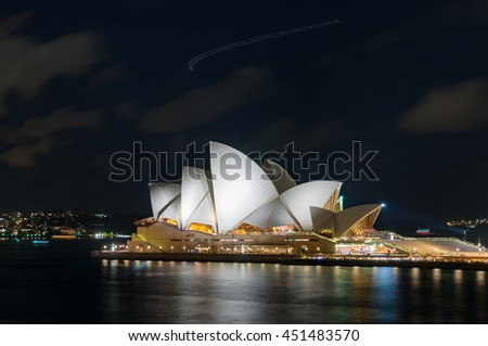 Sydney, Australia - Jul 10, 2016: Sydney Opera House at night. Iconic Sydney architecture sightseeing against dark sky on the background