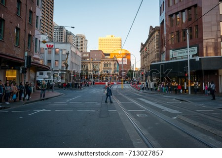 SYDNEY, AUSTRALIA - JULY 23, 2017: A person crossing the road in Haymarket, market city area of Sydney city