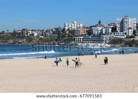 SYDNEY,AUSTRALIA-July 13, 2017:People and tourist relaxing and playing surfboards at Bondi beach  in Sydney, Australia . Bondi beach is one of a famous beach in the world. Holiday concept.