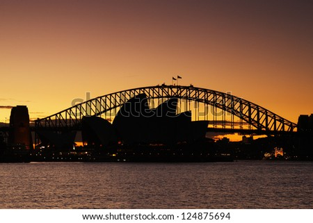 SYDNEY, AUSTRALIA - JULY 6: Sydney Harbour Bridge that carries rail, vehicular, bicycle and pedestrian traffic and Sydney Opera House, a multi-venue arts center. Picture taken on July 6, 2012. - stock photo