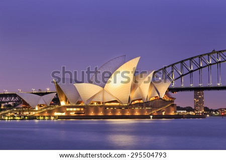 SYDNEY, AUSTRALIA, 10 JULY 2015 - Sydney opera house and Harbour bridge in Sydney at sunset. Iconic and world famous landmark of Australia viewed from Mrs Macquarie point in Royal Botanic Garden