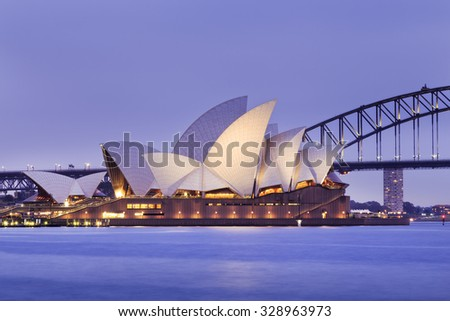 SYDNEY, AUSTRALIA, 10 JULY 2015 - Sydney opera house and Harbour bridge in Sydney at sunset. Iconic and world famous landmark of Australia viewed from Mrs Macquary point in Royal Botanic Garden