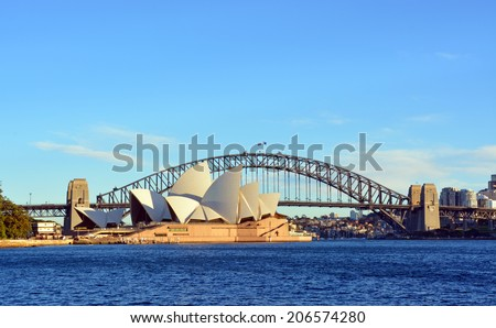 Sydney, Australia - July 17, 2014: Sydney Opera House & Bridge from Macquarie's Point on a beautiful winter's morning. - stock photo