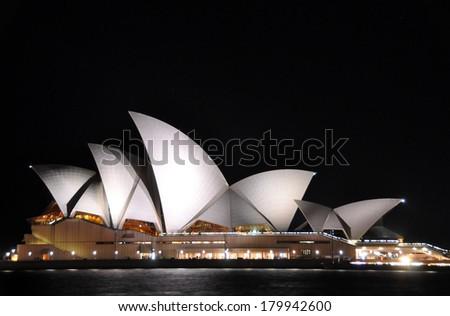 SYDNEY, AUSTRALIA - JULY 03, 2011: Sydney Opera House's amazing sails roof lit up on a winter's night, Australia. - stock photo