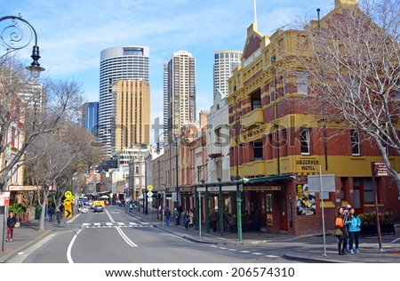 Sydney, Australia - July 19, 2014: Sydney's oldest district - The Rocks. A mecca for all tourists, shopping and restaurants.  - stock photo