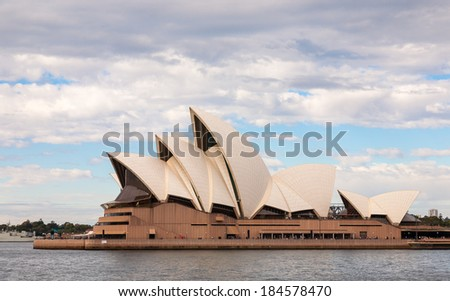 Sydney, Australia - July 11, 2010 : The Iconic Sydney Opera House is a multi-venue performing arts centre also containing bars and outdoor restaurants - stock photo