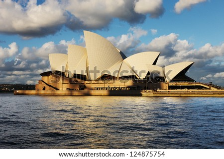 SYDNEY, AUSTRALIA - JULY 6: The Sydney Opera House as seen from the Sydney Harbour Ferry on July 6, 2012. A multi-venue arts center designed by Danish architect Jorn Utzon. Opned in 1973. - stock photo