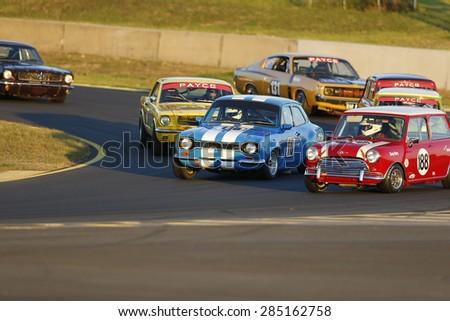 SYDNEY AUSTRALIA-JUNE 2015, David Noakes, blue Ford Escort (110) & Danny Berry, Morris Mini Cooper (188) in action at the Sydney Retro Speedfest, Sydney Motorsport Park, 6 & 7 June 2015, in Australia - stock photo