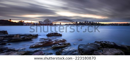 SYDNEY, AUSTRALIA - JUNE 23: Panorama view ofOpera house on June 23, 2013. This building is the landmark of Sydney city and Australia located in Sydney harbour.   - stock photo