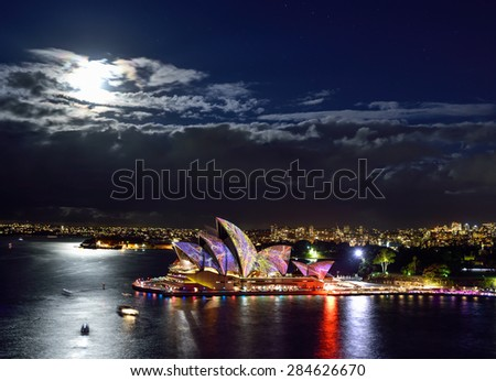 SYDNEY, AUSTRALIA - JUNE 5, 2015; Top view of The Sydney Opera House illuminated with colourful light design imagery, during the Vivid Sydney 2015 annual public event.