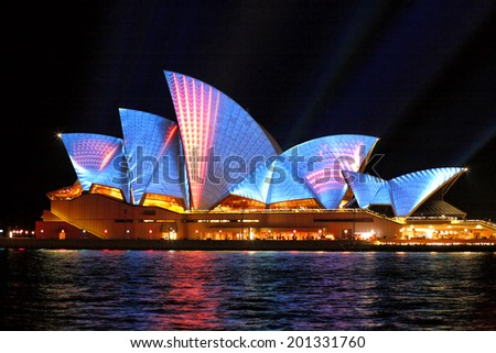 SYDNEY, AUSTRALIA - JUNE 2, 2014;  Vivid Sydney Festival, beautiful bright blue with red moving strips of light projected onto the  Sydney Opera House  during Vivid