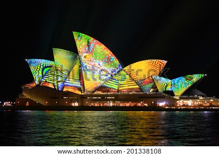SYDNEY, AUSTRALIA - JUNE 2, 2014;  Vivid Sydney Festival, the Sydney Opera House in summery colours of lime green, aqua, yellow and orange intricate patterns for Vivid  annual festival - stock photo
