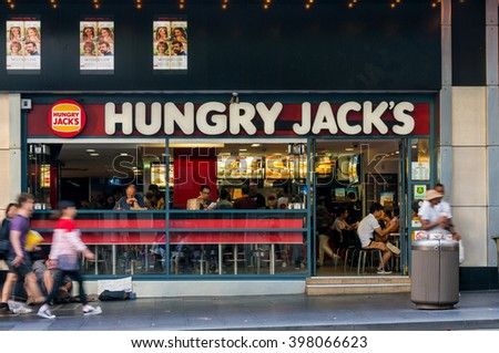 Sydney, Australia - Mar 26, 2016: Hungry Jacks fast food restaurant exterior on George street. Hungry Jacks is the exclusive Australian fast food franchise of Burger King Corporation. Motion blur